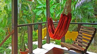 Costa Rica jungle bungalow hammock balcony view