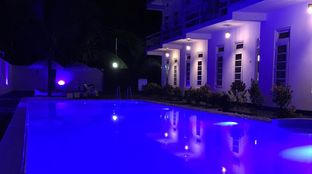 Surf House Sri Lanka pool night time lights