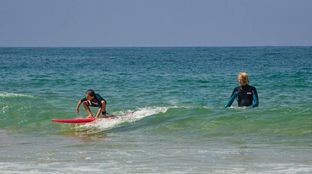 children learn to surf