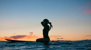 sunset surfer girl long board Caribbean