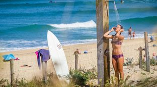 after surf shower bikini surfboard beach