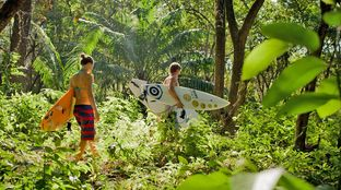 jungle walk with surfboard morning surf trip